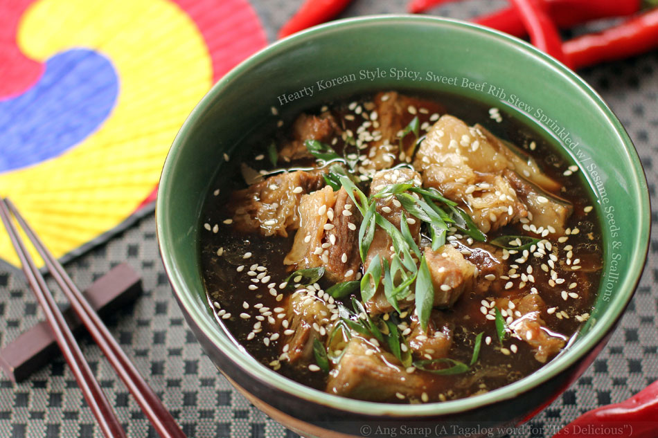 hearty-korean-style-spicy-sweet-beef-rib-stew-sprinkled-with-sesame-seeds-and-scallions