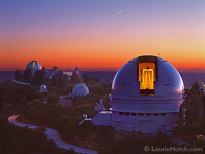 A westerly view of Lick Observatory and its open telescope domes after sunset.